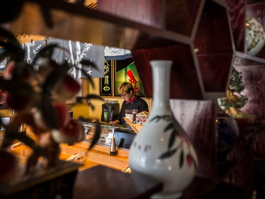Chef Fen Liu prepares the sushi bar at Asian Bistro