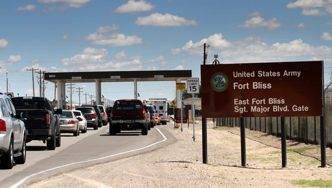 This Sept. 9, 2014, file photo shows cars waiting to enter Fort Bliss in El Paso.