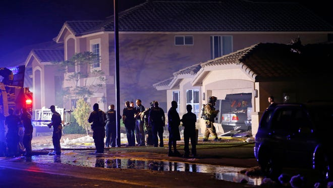 Gilbert Police and Fire Department work the scene of a small plane crash in the 400 block of East Baylor Lane on  Sept. 17, 2016, in Gilbert.