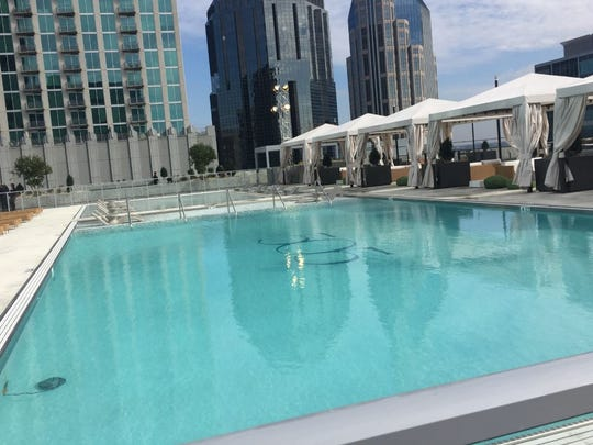 The swimming pool with cabanas on the amenity deck