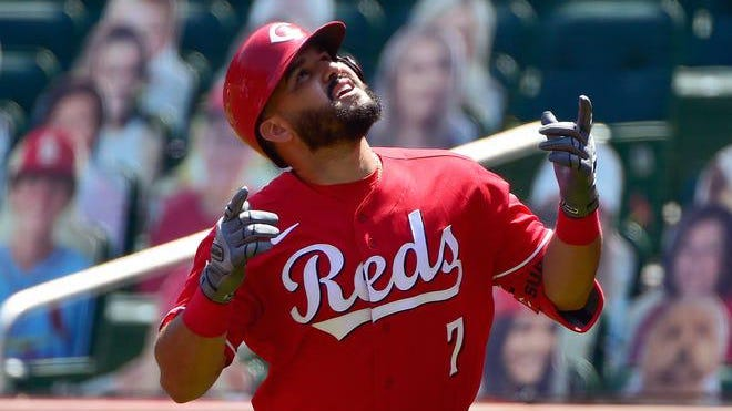 Cincinnati Reds third basement Eugenio Suarez (7) celebrates after hitting a two-run homer off St. Louis Cardinals pitcher Daniel Ponce de Leon during the first inning of a Major League Baseball game at Busch Stadium in St. Louis on Sunday Aug. 23, 2020.