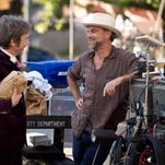 """This photo provided by Warner Bros. Pictures shows, actor Martin Short, left, and director/writer/producer, Paul Thomas Anderson, on the set of Warner Bros. Pictures' and IAC Films' """"Inherent Vice,"""" a Warner Bros. Pictures release. The movie releases Dec. 12, 2014."""