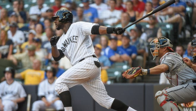 As a member of the Brewers, Chris Carter tied for the NL home run title with 41. Here's a hint of how he might look in the New York Yankees' pinstripes.