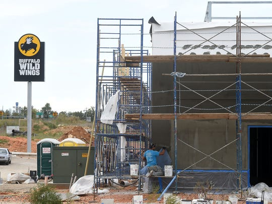 Commercial construction, such as the new Buffalo Wild Wings restaurant, accounted for the lion's share of building in Mountain Home during 2014. Construction values for the year topped $20.5 million.