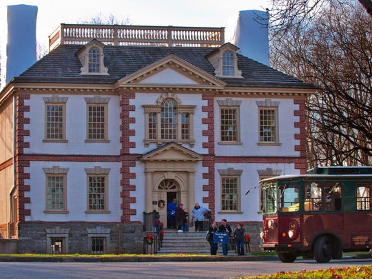 Visitors take a shuttle to Mount Pleasant, one of the homes featured in A Very Philly Christmas.