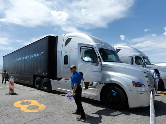 People load in to a Daimler Freightliner Inspiration