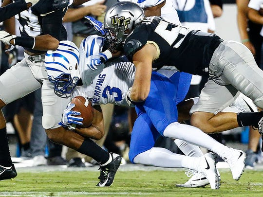 Memphis receiver Anthony Miller (left) is tackled by Central Florida defender Pat Jasinski (right) during the first quarter Saturday, Sept. 30, 2017.