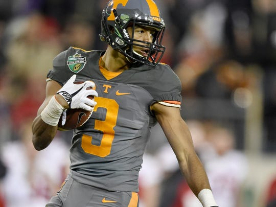 Tennessee Volunteers wide receiver Josh Malone (3) gains yards on his way to a touchdown during the second half of the Franklin American Mortgage Music City Bowl at Nissan Stadium in Nashville, Tenn., Friday, Dec. 30, 2016.
