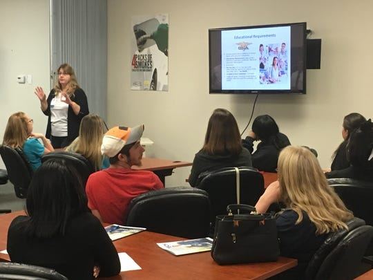 Karen Celec, a Lee Health recruiter, speaks to the audience at an informational event Wednesday at CareerSource Southwest Florida in Fort Myers.