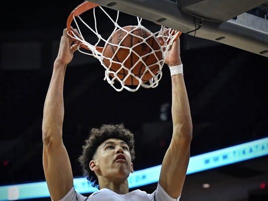 Moeller's Jaxson Hayes slams home 2 of his 14 points against Solon in the State Championship game Saturday, March 24th at Value City Arena