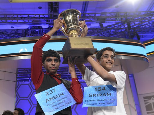 Ansun Sujoe and Sriram Hathwar celebrate being co-champions at the 2014 Scripps National Spelling Bee.