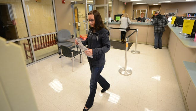 Rachael Vanden Langenberg goes through the early voting process at the Green Bay city clerk's office on Thursday.