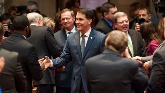 Gov. Scott Walker is greeted by political colleagues prior to his State of the State address on Jan. 10.