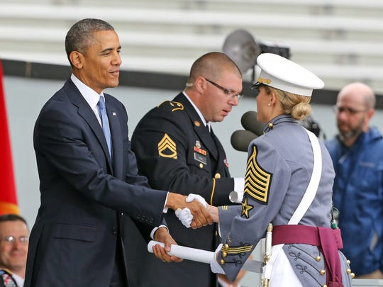 President Barack Obama presents a diploma to Lindsey Bryant Danilack, the cadet first captain and brigade commander for the 2014 United States Military Academy graduating class, during commencement exercises at West Point Wednesday. The President spoke during commencement, laying out his vision for American foreign policy after the nation fought two wars since the attacks of Sept. 11, 2001.