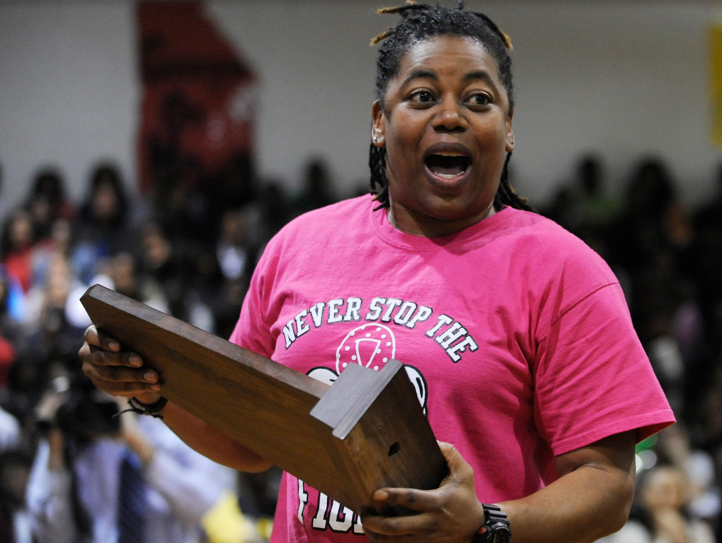 Jeff Davis girls basketball coach LaKenya Knight holds the 7A State Championship Trophy as the team is honored during a ceremony at the school in Montgomery, Ala. on Thursday March 5, 2015.