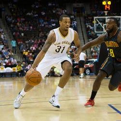 Atlanta Hawks guard Shelvin Mack (8) defends New Orleans Pelicans guard Bryce Dejean-Jones (31) in the 3rd quarter at Veterans Memorial Arena.