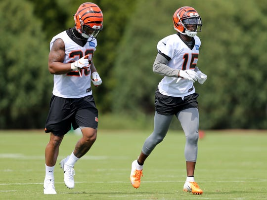 Cincinnati Bengals running back Joe Mixon (28) and  wide receiver John Ross have had excellent training camps thus far.