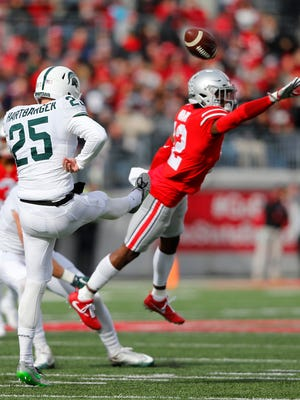 Jake Hartbarger nearly has his punt blocked by Ohio State cornerback Denzel Ward in the second quarter Saturday.
