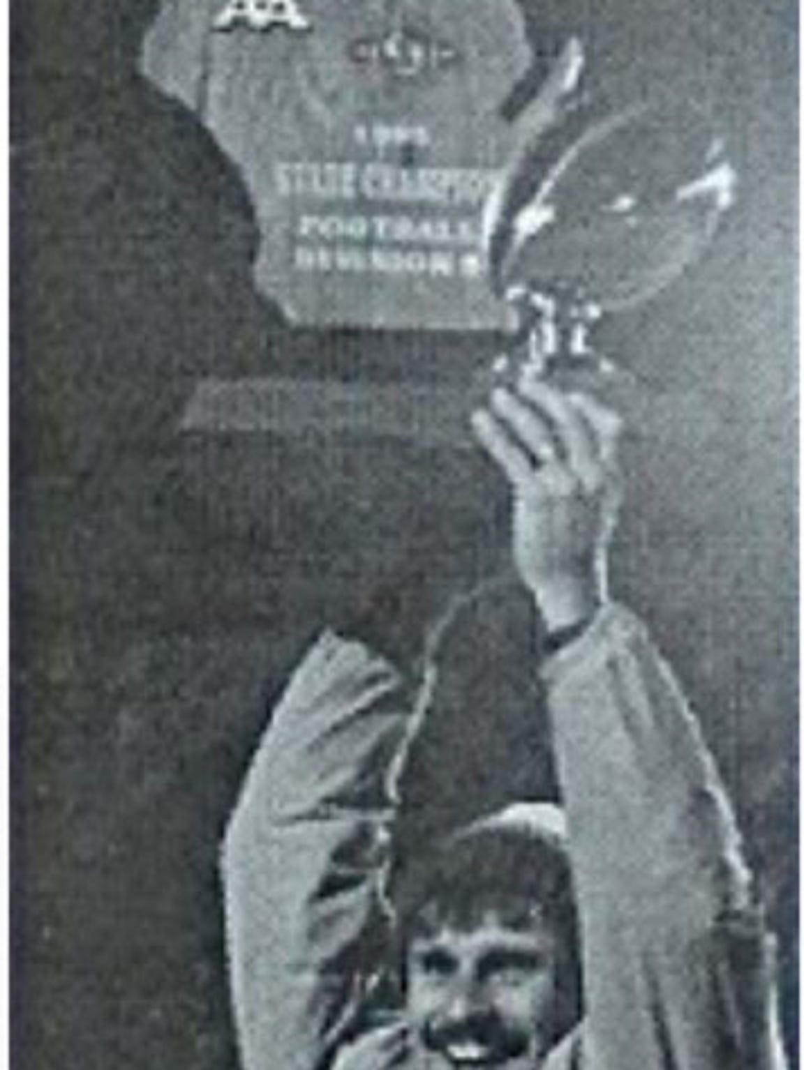 New Berlin Eisenhower coach Jeff Setz hoists the 1995