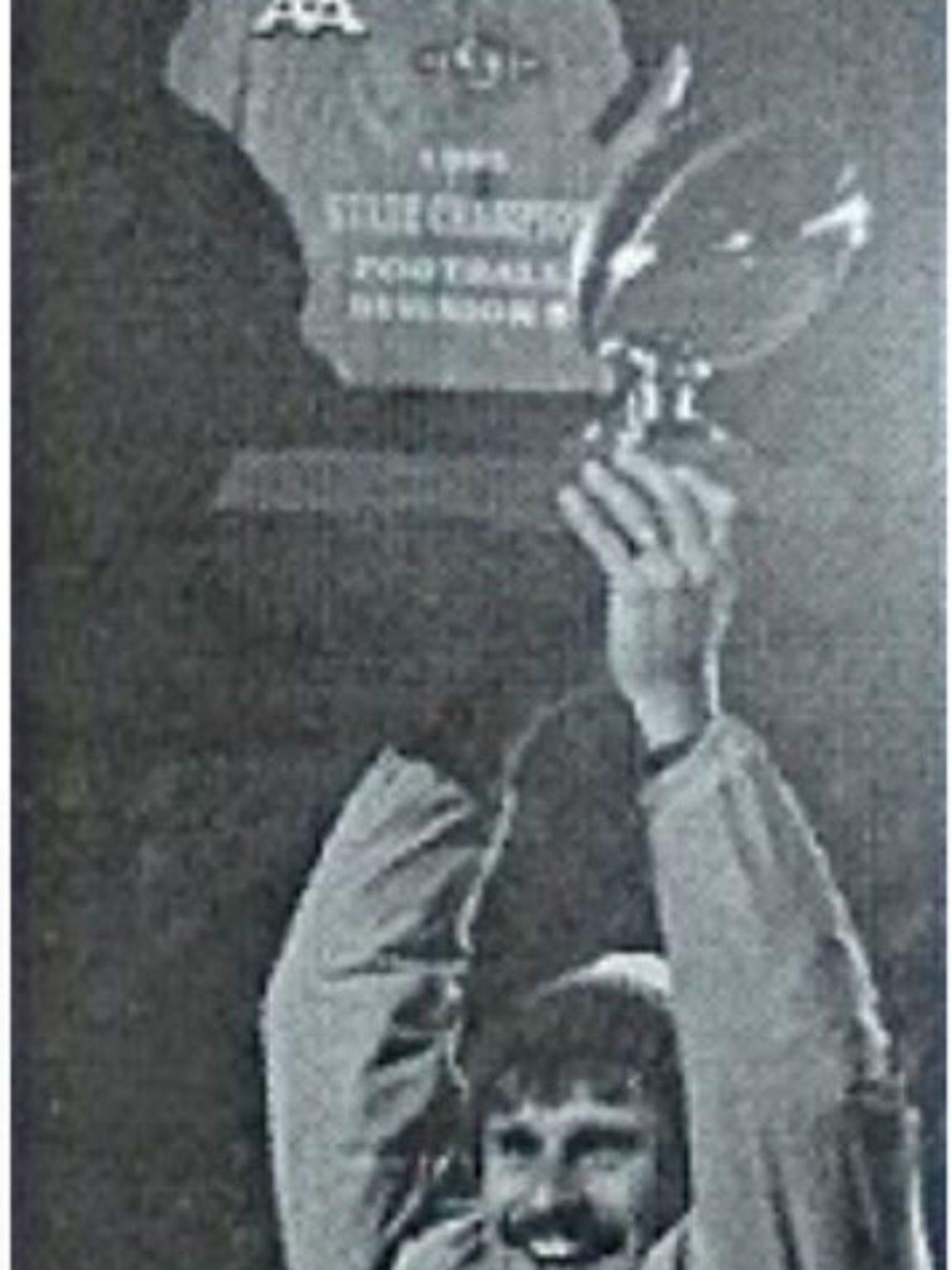 New Berlin Eisenhower coach Jeff Setz hoists the 1995