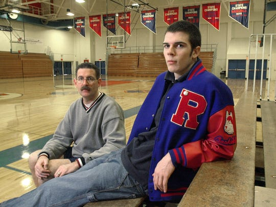 Reno High basketball coach Pete Padgett, left, and