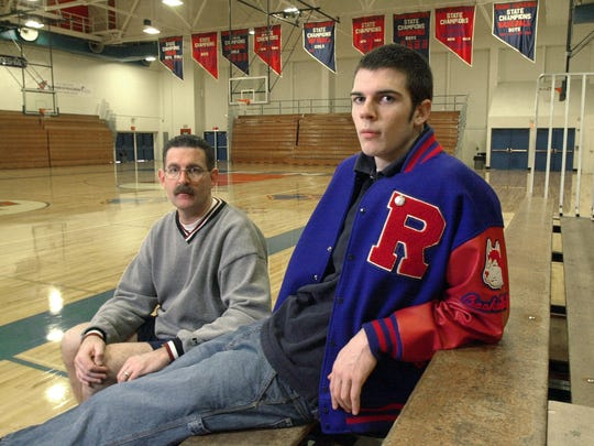 Reno High basketball coach Pete Padgett, left, and his son and star player, David Padgett, in 2002.