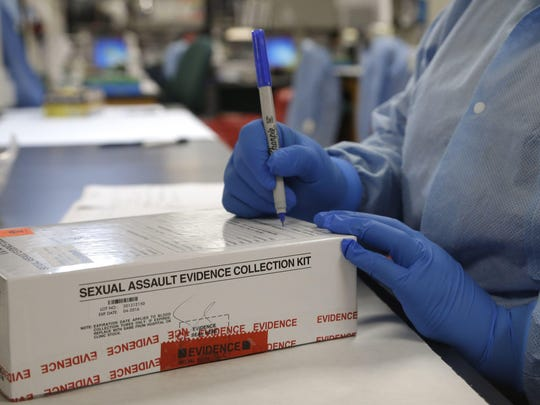 "A sexual assault evidence collection kit is checked in by a forensic analyst for testing in the biology lab at the Houston Forensic Science Center in Houston. Former Florida Gov. Rick Scott signed legislation in 2016 requiring police agencies to submit ""rape kit"" results for processing within 30 days."