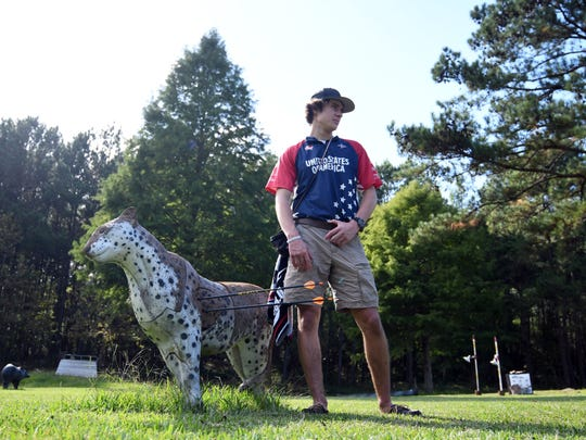 Gabe Crenshaw stands alongside a 3D archery target in the backyard of his family's Hattiesburg home. Crenshaw represented the United States last month at the 3D World Archery Championships in Robion, France.