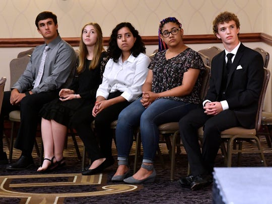Gold Star Students listen as Evan Simmons introduces them Tuesday at the Star Student Awards banquet at Abilene Christian University. High school juniors were honored at three color levels.