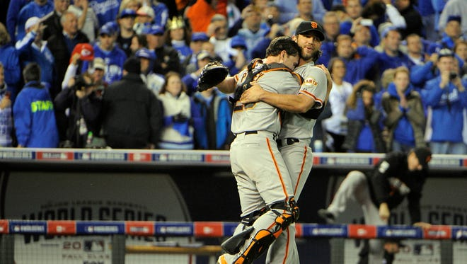 Oct 29, 2014: San Francisco Giants pitcher Madison Bumgarner (right) celebrates with catcher Buster Posey (left) after defeating the Kansas City Royals during game seven of the 2014 World Series at Kauffman Stadium.