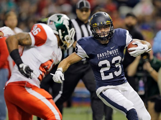 West running back Daniel Lasco (23), of California, cuts in front of East Linebacker Darien Harris (46), of Michigan State, after a long run during the first half of the East West Shrine football game Saturday, Jan. 23, 2016, in St. Petersburg, Fla.
