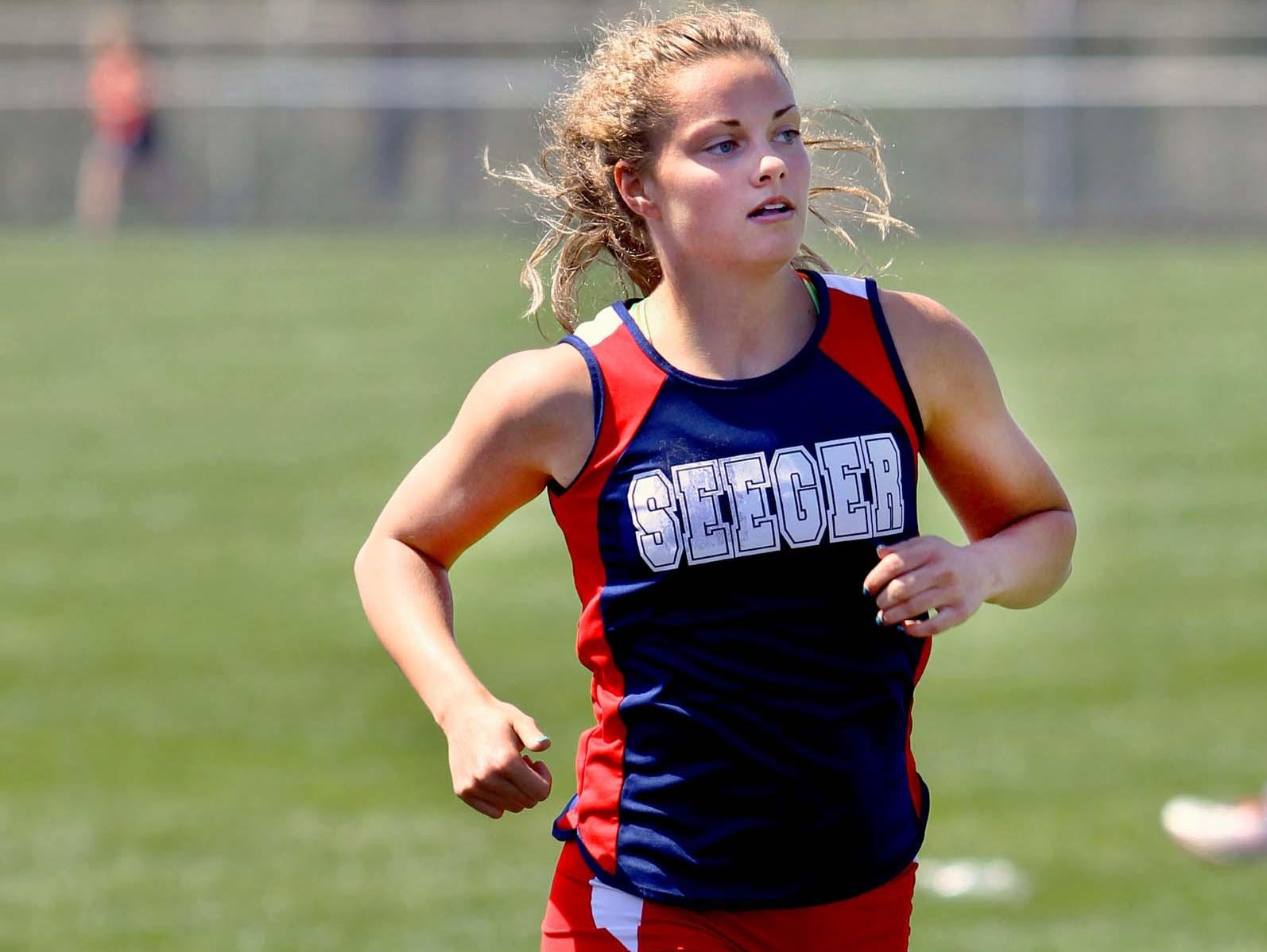 Becca Haussin of Seeger won the 800-meter race at the Covington Invitational track meet.