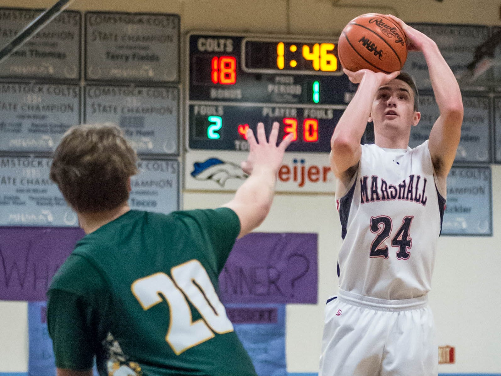 Marshall's Drew DeVine (24) takes the shot during Monday's district game against Pennfield.