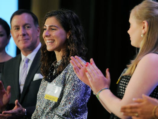 Elise Hirt, center, smiles as she receives the Youth Volunteer Award at The Strobel Awards. The awards, hosted by Hands On Nashville, are Middle Tennessee's highest volunteer honor. Winners were announced on Tuesday April 22, 2014.