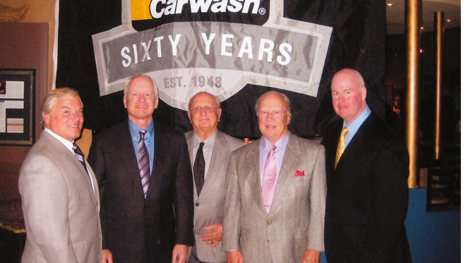 Mike's Carwash co-founder, Edward Dahm, fourth from the right, died in a crash with a charter bus on Thursday.