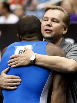 Men's gymnastics coach Vitaly Marinitch was asked to resign in September.  (right) after competing on the floor exercise portion at the 2014 P&G Championships at the CONSOL Energy Center. Mandatory Credit: Charles LeClaire-USA TODAY Sports usp ORG XMIT: USATSI-188736 [Via MerlinFTP Drop]