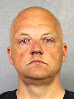 FILE - This January 2017 file photo provided by the Broward County Sheriff's Office shows German Volkswagen executive Oliver Schmidt. Schmidt, a former manager of a VW engineering office in suburban Detroit, pleaded guilty Friday, Aug. 4, 2017, to conspiracy and fraud charges in Detroit in a scheme to cheat emission rules on nearly 600,000 diesel vehicles. (Broward County Sheriff's Office via AP, File) ORG XMIT: CER102
