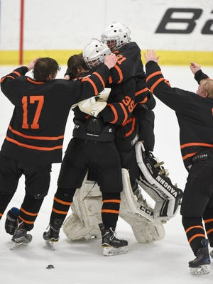 Brighton celebrates winning the state Division 1 hockey championship after a 5-2 victory over Saginaw Heritage on March 10, 2018 at USA Hockey Arena in Plymouth.
