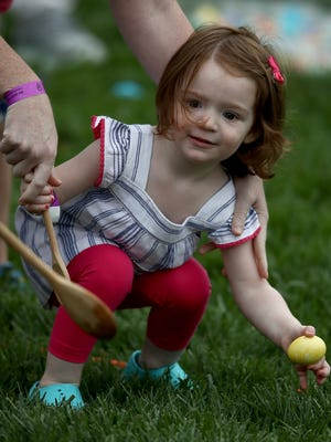 A young guest prepares to roll her Easter Egg on the South Lawn of the White House April 17, 2017.