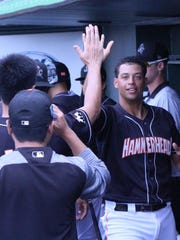 Joe Dunand celebrates with Wei-Yin Chen after scoring what would be Jupiter's only run in a 1-0 win over the St. Lucie Mets.