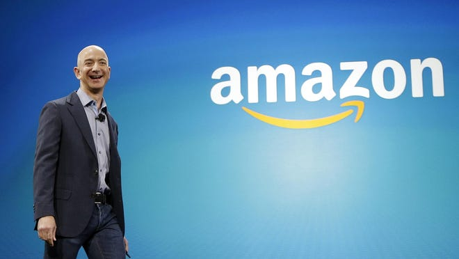 In this June 16, 2014, file photo, Amazon CEO Jeff Bezos walks onstage for the launch of the new Amazon Fire Phone, in Seattle. With a net worth of more than $200 billion, Bezos is the richest person in the world.