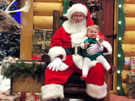 Baby Emery Lane's first meeting with Santa did not go well. The picture is included in her email account, which is doubling as a baby book.