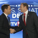 Sen. Marco Rubio, R-Fla., left, and Rep. Patrick Murphy, D-Fla., shake hands before their debate at the University of Central Florida, Monday in Orlando.
