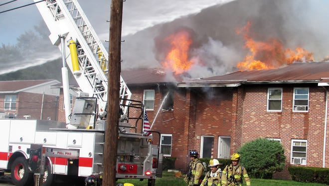 Elmira firefighters battle a blaze Sunday afternoon at Riverview Apartments North on DeWitt Avenue.
