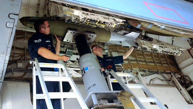 Staff Sgt. Aaron Vansant (left) and Staff Sgt. Donald Winters secure a 2,000-pound bomb into place in the bomb bay of a B-1B Lancer while competing in the Global Strike Challenge 2017 on Tuesday, June 13, 2017, at Dyess Air Force Base.