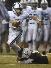 Memorial quarterback Michael Lindauer tries to scramble as he is brought down by Kiave Guerrier of Central during the second quarter of the game at Central Stadium in Evansville Friday.