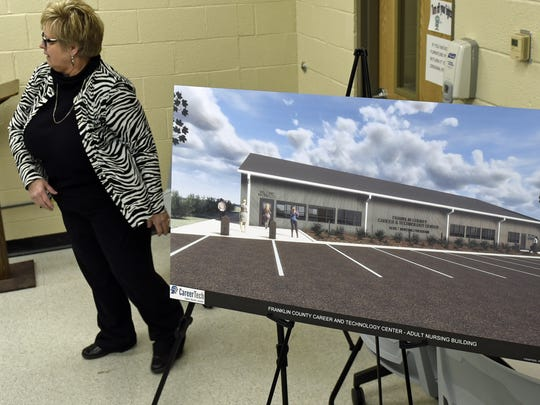 FCCTC Practical Nursing Program Nursing Administrator Janyce Collier stands beside a computer drawing off the planned center. Franklin County Practical Nursing Program held a groundbreaking ceremony Thursday, December 8, 2016, for the planned new building on the Franklin County Career and Technology Center grounds.