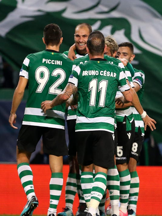 Sporting's Bas Dost, background center, celebrates with team mates after scoring his side's opening goal during a Champions League, Group D soccer match between Sporting CP and Olympiakos at the Alvalade stadium in Lisbon, Wednesday Nov. 22, 2017. (AP Photo/Armando Franca)