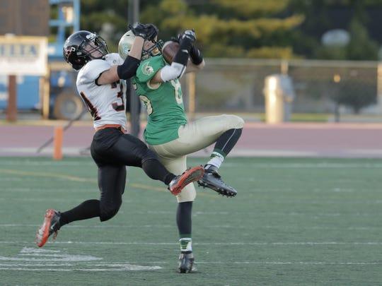 Oshkosh North's Mitch Sundstrom intercepts the ball