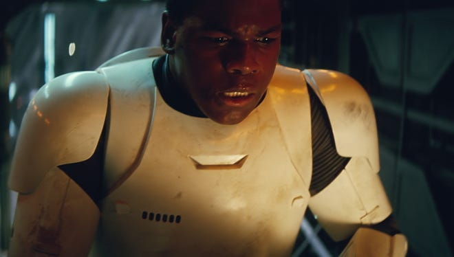 John Boyega's Finn goes from First Order Stormtrooper to hero in 'Star Wars: The Force Awakens.'